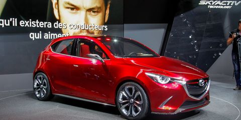 Mode of transport, Automotive design, Vehicle, Event, Car, Automotive lighting, Logo, Alloy wheel, Vehicle door, Automotive mirror,