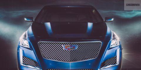 Automotive design, Blue, Vehicle, Grille, Car, Hood, Automotive lighting, Personal luxury car, Electric blue, Sports car,