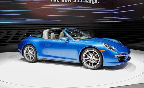 Tire, Wheel, Automotive design, Blue, Vehicle, Alloy wheel, Car, Automotive wheel system, Rim, Performance car,