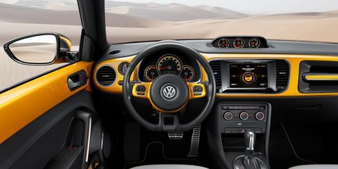 Motor vehicle, Steering part, Mode of transport, Automotive design, Steering wheel, Transport, Yellow, Vehicle, Automotive mirror, Center console,