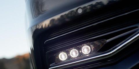 Motor vehicle, Grille, Automotive lighting, Automotive exterior, Light, Close-up, Bumper, Hood, Personal luxury car, Automotive light bulb,