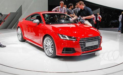 Tire, Wheel, Automotive design, Vehicle, Event, Land vehicle, Car, Red, Grille, Auto show,