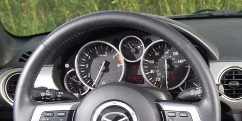 Mode of transport, Automotive design, Transport, Speedometer, Steering wheel, White, Tachometer, Gauge, Trip computer, Steering part,