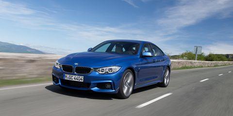 Road, Automotive design, Blue, Automotive exterior, Hood, Rim, Grille, Car, Vehicle registration plate, Road surface,
