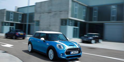 Automotive design, Blue, Vehicle, Window, Land vehicle, Road, Car, Vehicle door, Mini cooper, Automotive mirror,