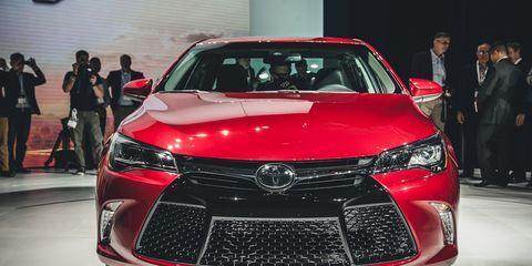 Automotive design, Vehicle, Land vehicle, Event, Car, Auto show, Exhibition, Suit, Fashion, Luxury vehicle,