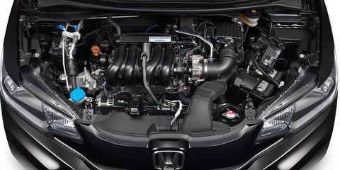 Automotive design, Engine, Car, Automotive exterior, Automotive engine part, Luxury vehicle, Personal luxury car, Automotive air manifold, Automotive super charger part, Fuel line,