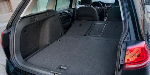 Vehicle, Trunk, Automotive exterior, Automotive tail & brake light, Vehicle door, Car, Glass, Automotive parking light, Car seat, Bumper,