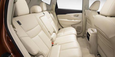 Motor vehicle, Mode of transport, Car seat, Fixture, Vehicle door, Head restraint, Car seat cover, Seat belt, Luxury vehicle, Family car,