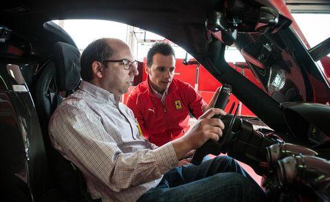 Motor vehicle, Automotive design, Car seat, Sitting, Steering wheel, Steering part, Windshield, Automotive window part, Driving, Vehicle door,