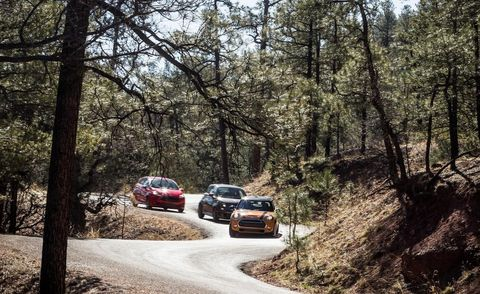 Motor vehicle, Road, Automotive exterior, Automotive lighting, Automotive parking light, Automotive mirror, Sport utility vehicle, Trunk, Forest, Automotive tail & brake light,