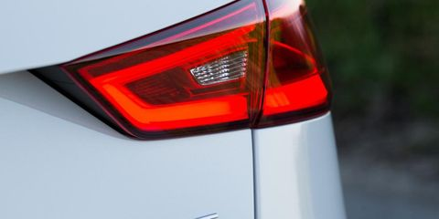 Automotive tail & brake light, Automotive design, Automotive lighting, Automotive exterior, Red, Light, Logo, Luxury vehicle, Personal luxury car, Automotive light bulb,