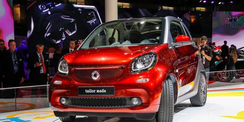 Motor vehicle, Automotive design, Vehicle, Event, Land vehicle, Car, Grille, Automotive lighting, Auto show, Exhibition,