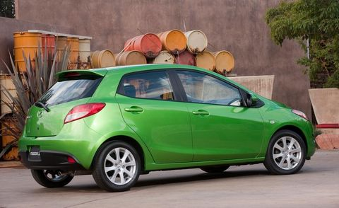 Tire, Motor vehicle, Wheel, Automotive mirror, Mode of transport, Automotive design, Vehicle, Car, Glass, Vehicle door,