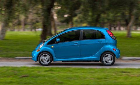 Tire, Wheel, Motor vehicle, Automotive design, Blue, Vehicle, Automotive wheel system, Car, Hatchback, Vehicle door,
