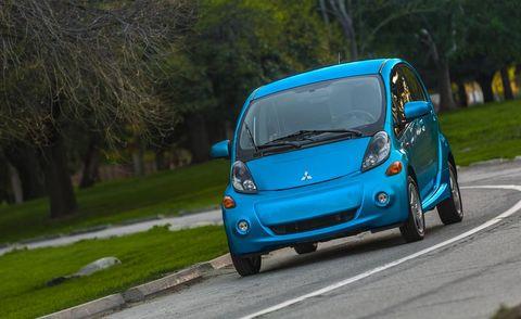 Motor vehicle, Automotive design, Blue, Vehicle, Car, Automotive mirror, Electric blue, Azure, City car, Rear-view mirror,