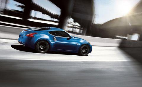Wheel, Tire, Automotive design, Mode of transport, Vehicle, Automotive lighting, Car, Fender, Automotive exterior, Performance car,