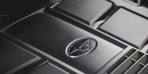 Product, Logo, Black, Metal, Symbol, Carbon, Emblem, Brand, Luxury vehicle, Gadget,