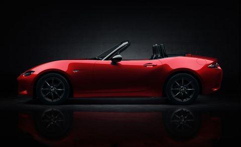Automotive design, Red, Car, Convertible, Roadster, Fender, Sports car, Alloy wheel, Automotive lighting, Performance car,