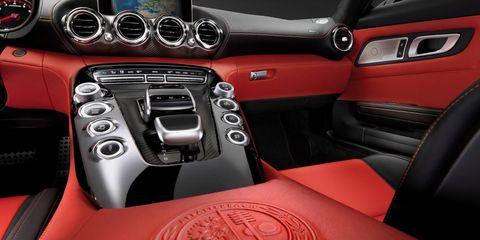 Motor vehicle, Steering part, Automotive design, Steering wheel, Center console, Vehicle audio, Red, Gear shift, Speedometer, Luxury vehicle,