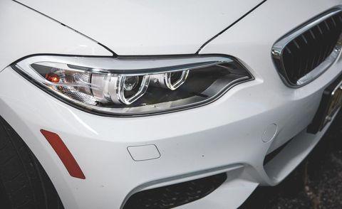 Automotive design, Daytime, Automotive lighting, Vehicle, Automotive exterior, Hood, Headlamp, Grille, Car, White,