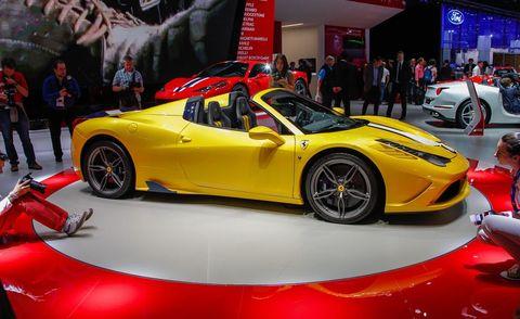 Tire, Wheel, Automotive design, Mode of transport, Vehicle, Land vehicle, Event, Yellow, Performance car, Car,