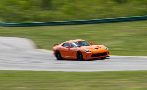 Tire, Wheel, Automotive design, Vehicle, Road, Performance car, Car, Motorsport, Automotive lighting, Race track,