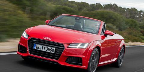 Automotive design, Mode of transport, Vehicle, Transport, Automotive mirror, Land vehicle, Red, Car, Grille, Personal luxury car,