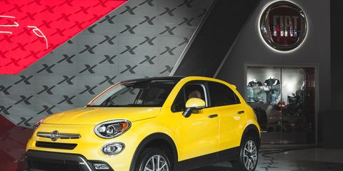 Motor vehicle, Tire, Wheel, Automotive design, Vehicle, Yellow, Automotive tire, Land vehicle, Automotive lighting, Automotive wheel system,