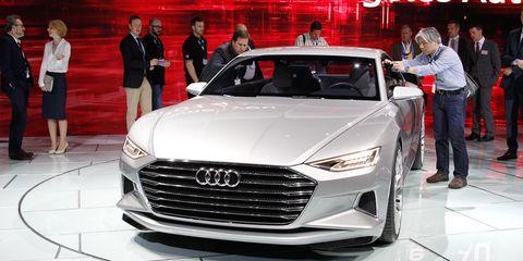 Automotive design, Vehicle, Event, Land vehicle, Grille, Car, Personal luxury car, Auto show, Exhibition, Luxury vehicle,