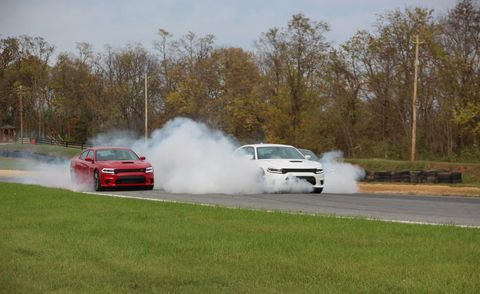Vehicle, Automotive design, Motorsport, Smoke, Car, Automotive exterior, Racing, Automotive tire, Performance car, Auto racing,