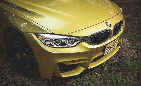 Automotive design, Green, Yellow, Automotive exterior, Hood, Vehicle, Grille, Automotive lighting, Photograph, Car,