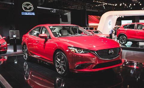 Wheel, Automotive design, Land vehicle, Vehicle, Event, Car, Auto show, Personal luxury car, Exhibition, Alloy wheel,
