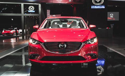 Automotive design, Vehicle, Land vehicle, Event, Car, Grille, Personal luxury car, Auto show, Exhibition, Automotive lighting,
