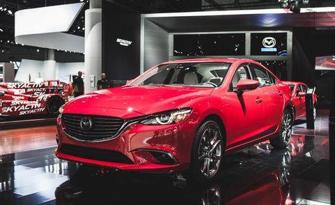 Automotive design, Vehicle, Event, Land vehicle, Car, Grille, Exhibition, Auto show, Personal luxury car, Automotive lighting,