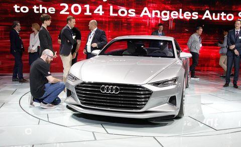 Automotive design, Event, Vehicle, Land vehicle, Grille, Car, Personal luxury car, Luxury vehicle, Auto show, Logo,