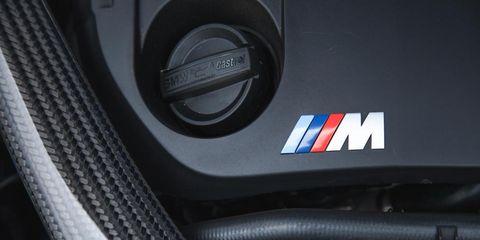 Motor vehicle, Automotive design, Logo, Grey, Carbon, Cable, Symbol, Machine, Trademark, Wire,