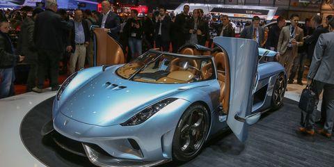 Mode of transport, Automotive design, Vehicle, Land vehicle, Car, Supercar, Auto show, Headlamp, Exhibition, Personal luxury car,