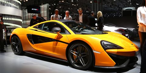 Automotive design, Vehicle, Yellow, Land vehicle, Car, Supercar, Auto show, Sports car, Exhibition, Performance car,