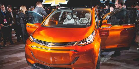 Automotive design, Vehicle, Land vehicle, Event, Car, Auto show, Exhibition, Amber, Orange, Personal luxury car,
