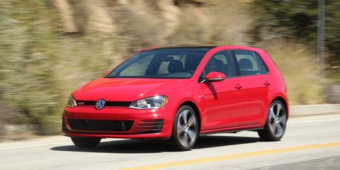 Tire, Automotive design, Daytime, Vehicle, Automotive mirror, Car, Road, Rim, Alloy wheel, Red,