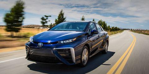 Motor vehicle, Automotive design, Daytime, Vehicle, Land vehicle, Road, Headlamp, Automotive lighting, Grille, Car,