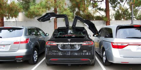 Automotive design, Vehicle, Automotive tail & brake light, Land vehicle, Car, Trunk, Automotive exterior, Luxury vehicle, Personal luxury car, Rim,