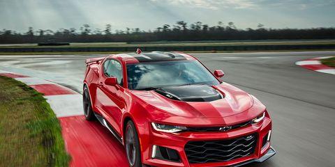 Automotive design, Vehicle, Grille, Hood, Automotive lighting, Car, Headlamp, Red, Performance car, Fender,
