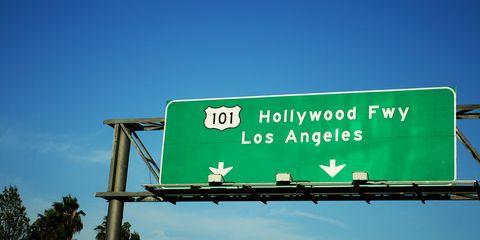 Daytime, Sky, Green, Infrastructure, Street sign, Sign, Signage, Landmark, Teal, Rectangle,