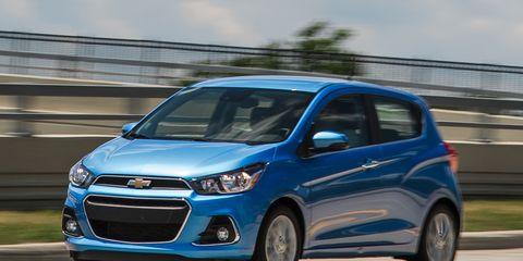 Motor vehicle, Tire, Wheel, Automotive design, Blue, Daytime, Vehicle, Transport, Automotive mirror, Car,