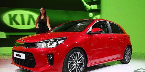 Tire, Motor vehicle, Wheel, Automotive design, Vehicle, Event, Car, Automotive tire, Automotive lighting, Red,