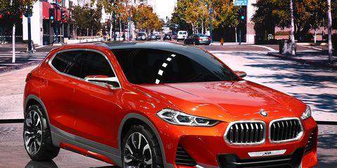 Automotive design, Vehicle, Land vehicle, Car, Red, Alloy wheel, Grille, Automotive wheel system, Rim, Automotive tire,