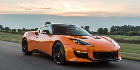 Tire, Wheel, Automotive design, Hood, Performance car, Infrastructure, Rim, Car, Automotive lighting, Road,
