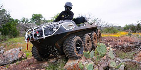 Automotive tire, Helmet, Plant community, Military vehicle, Auto part, Fender, Tread, Off-road vehicle, Automotive wheel system, All-terrain vehicle,